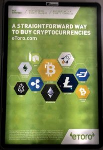 Advertisement for eToro cyrptocurrency platform on Dublin public transport. Interest in cryptocurrencies has increased greatly in Ireland.