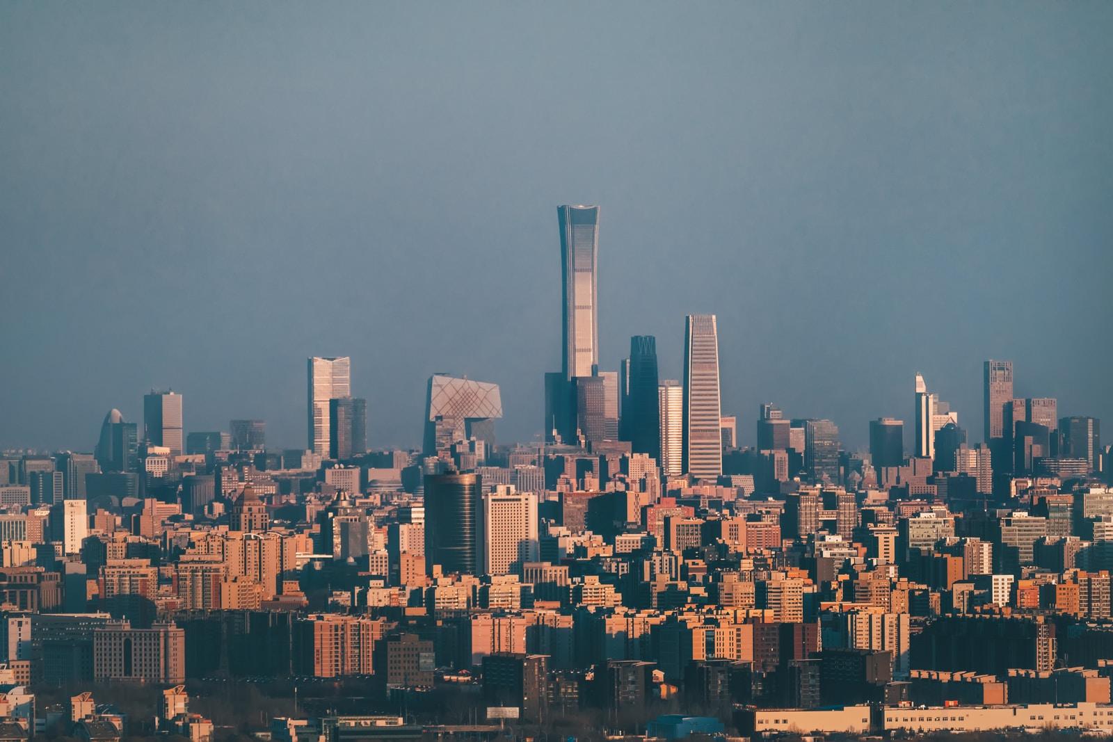 city skyline under gray sky during daytime